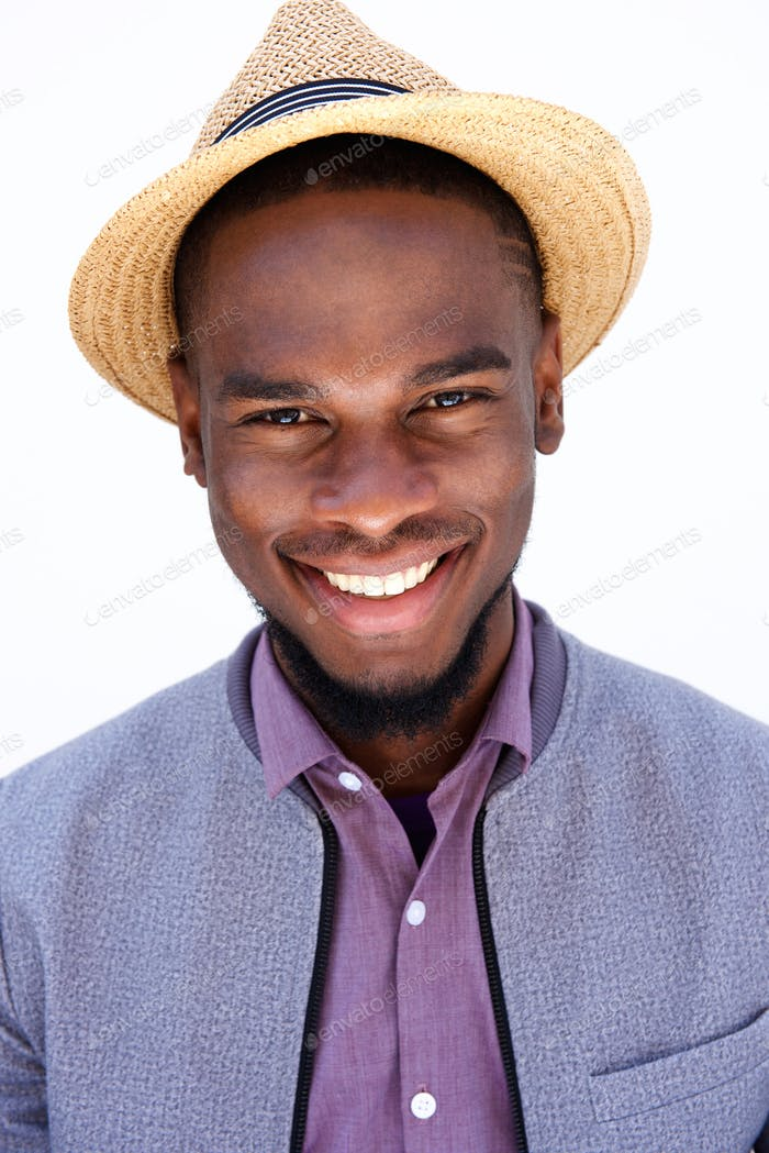 Happy young african guy wearing hat