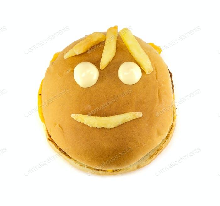 Taza divertida de una hamburguesa con queso y papas fritas