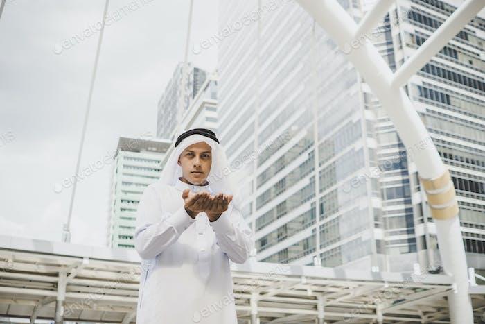 Muslim young man is praying