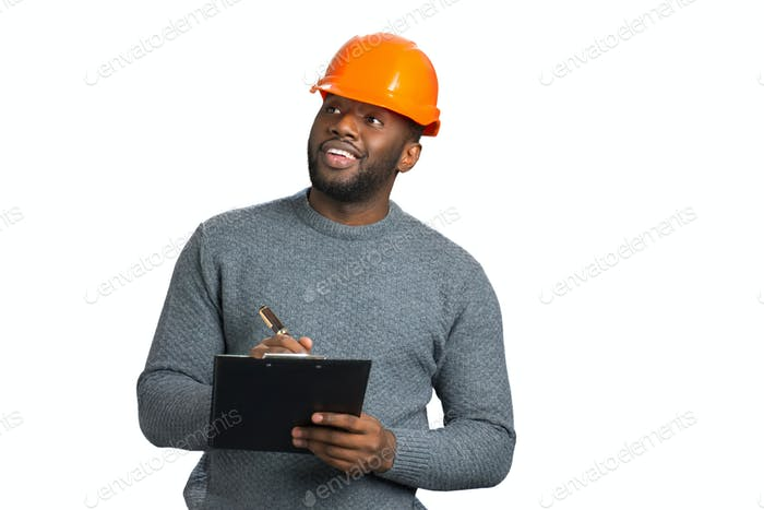 Foreman in casual wear checking object
