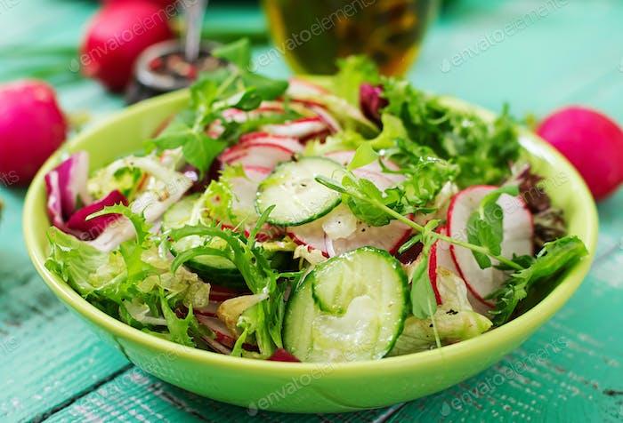 Fresh salad of cucumbers, radishes and herbs