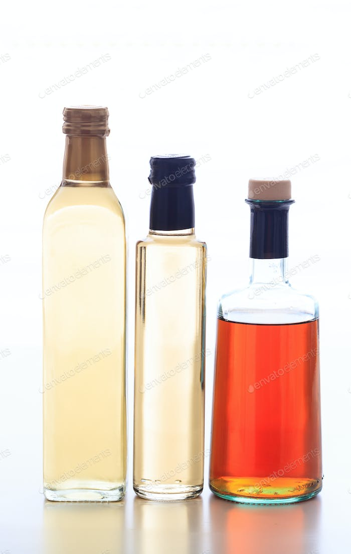 Vinegar variation bottled isolated against white background.