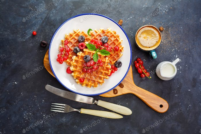 Waffles with fresh berries and honey