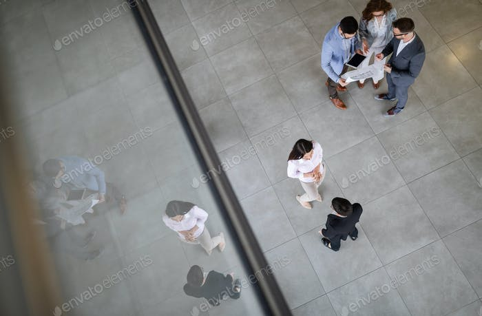 Business people working together in office hall
