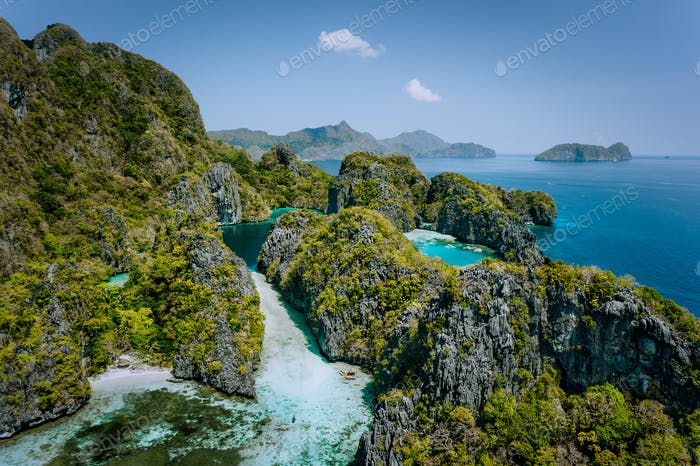 Aerial drone view of turquoise big and small lagoons surrounded by steep rocks, Marine National