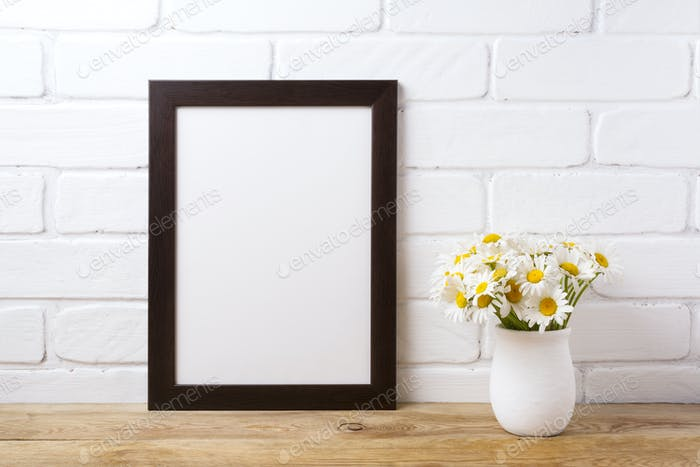 Black brown  frame mockup with chamomile bouquet in rustic vase