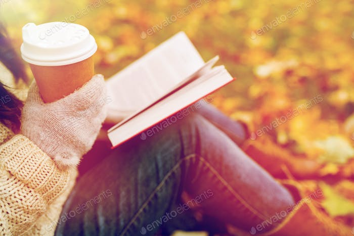 Thumbnail for woman with book drinking coffee in autumn park