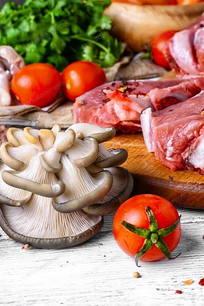 Raw meat on cutting board