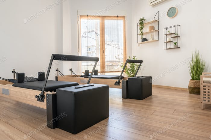 Pilates studio room with reformer beds