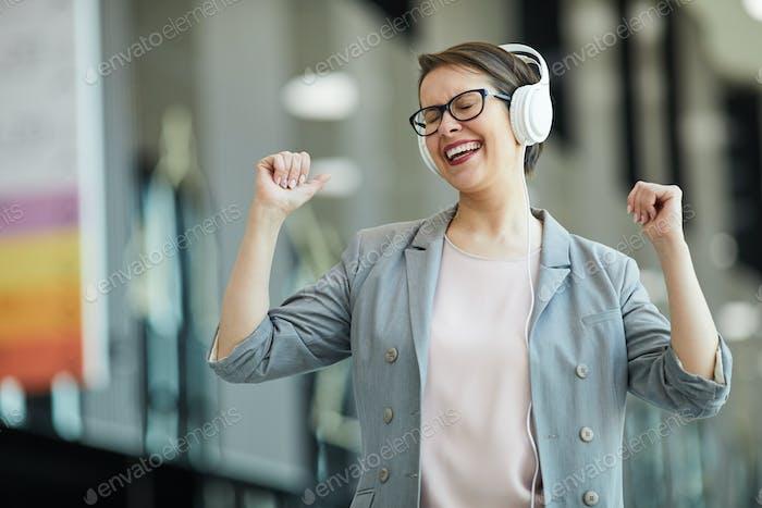 Jolly woman dancing in excitement