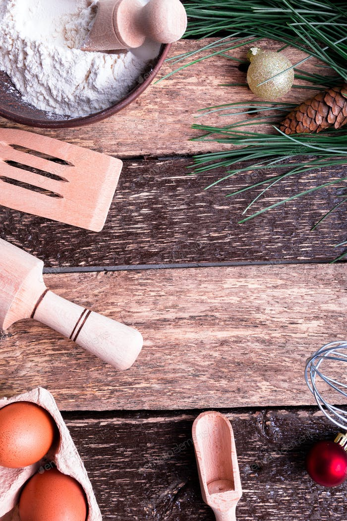 Ingredients for cooking Christmas baking on wooden background