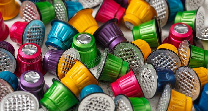 Colorful used coffee capsules background. Closeup view with details