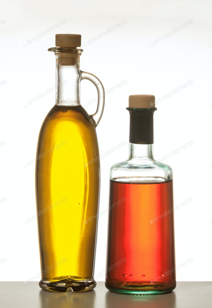 Olive oil and vinegar bottled isolated against white background.
