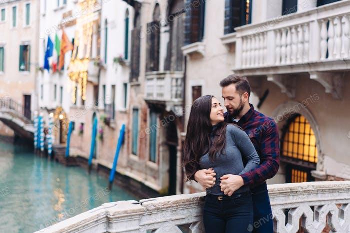 Loving couple on the one of bridge