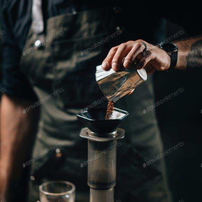 Barista Pouring Coffee Into Aeropress Coffee Maker