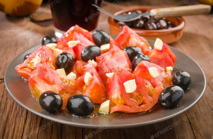 homemade salad olives and tomatoes cut with garlic