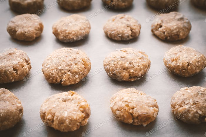 Oatmeal cookies on a baking sheet covered with parchment