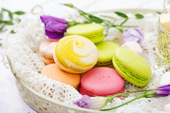 Colorful macaroons and marshmallows on a ligth  background.