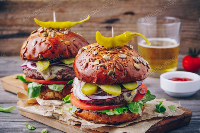 homemade burgers with whole grain bun and spicy pickled peppers