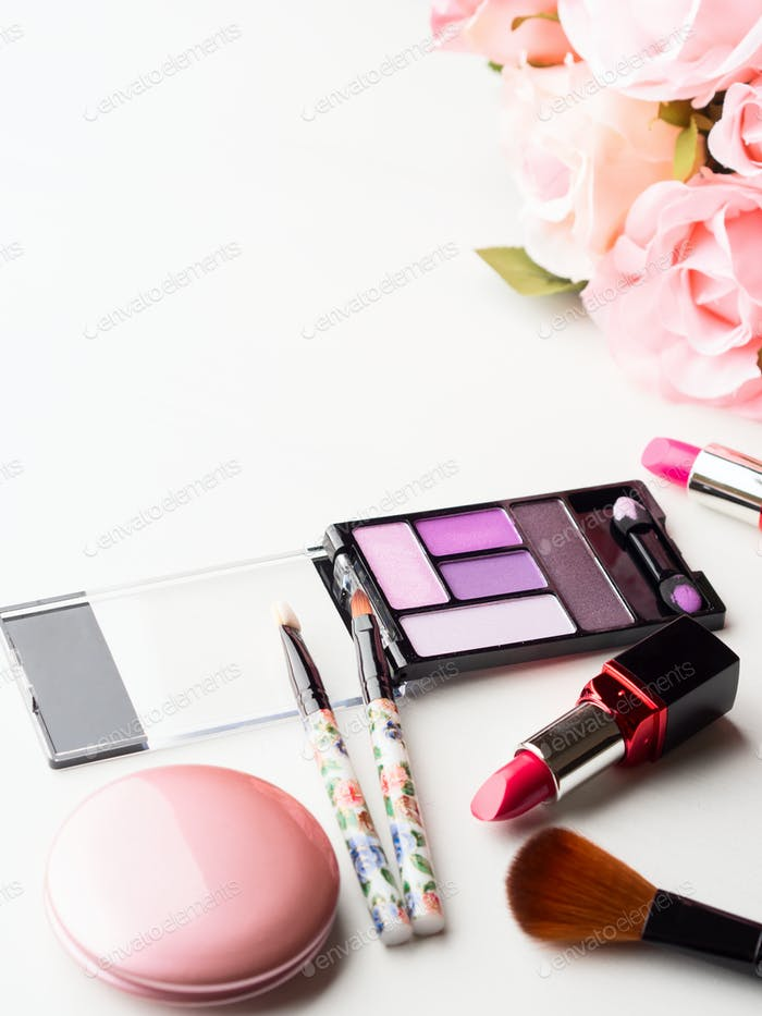Make up products and tools with pink roses