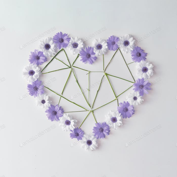 Heart shape made of violet and white daisies with low poly flower stems.