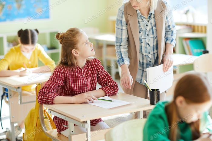 Elementary student advising teacher during test