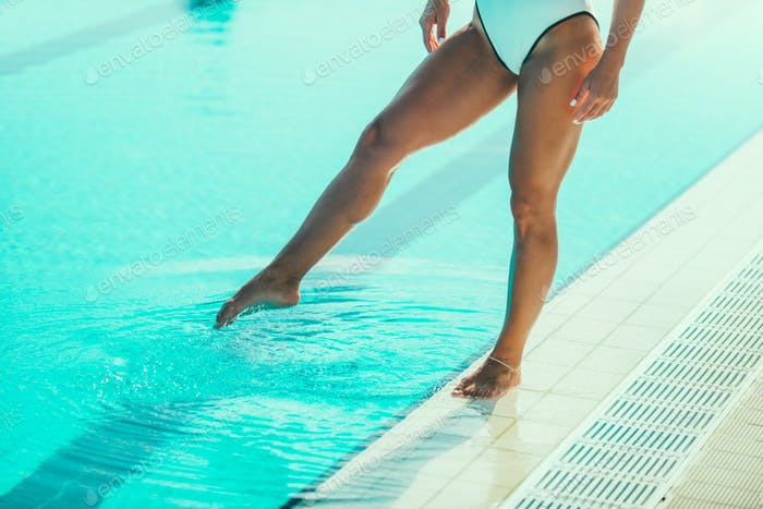 Female swimmer on poolside