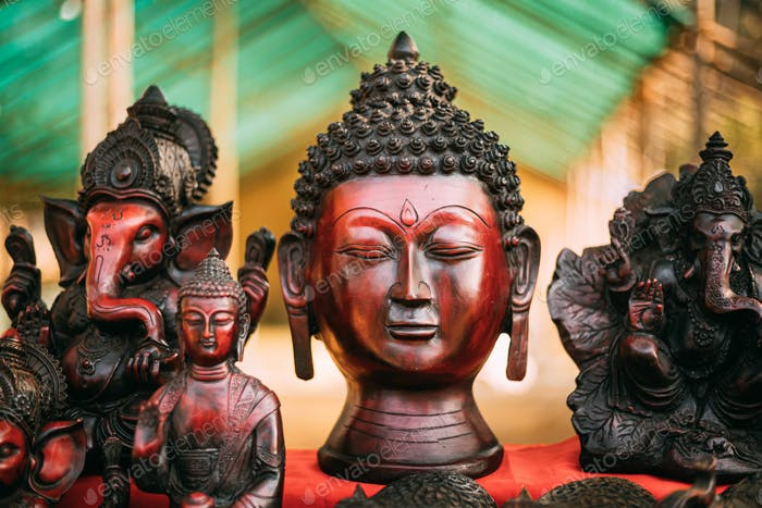Goa, India. Traditional Store With Statues Different Colors And Sizes. Statues Of Buddha Head And