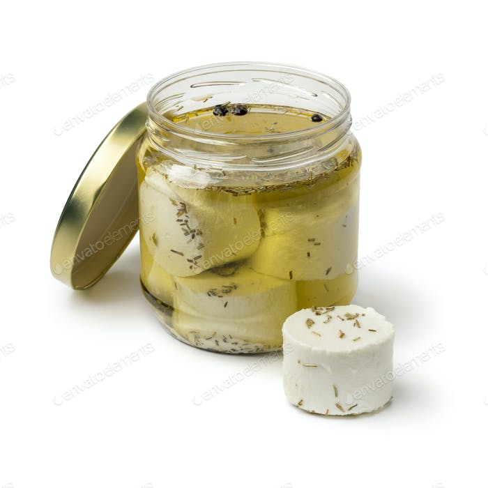 Jar with preserved white organic Dutch goat cheese