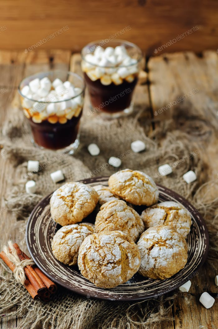 Pumpkin cookies with cups of coffee