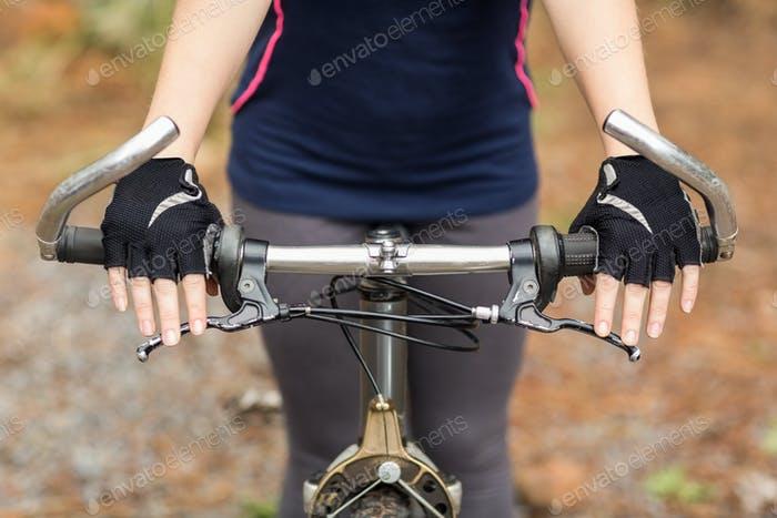 Close up view of hands on handlebar in the nature
