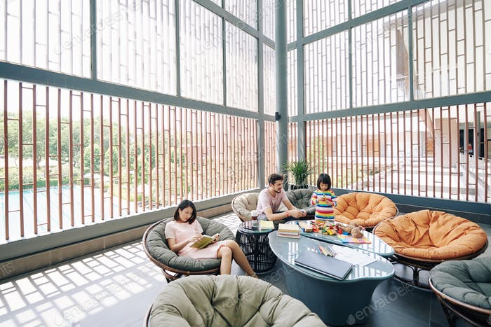 Family resting in hotel lounge area