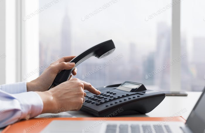Female office worker making a phone call