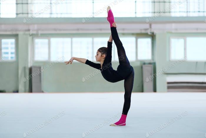 girl making a balance in training