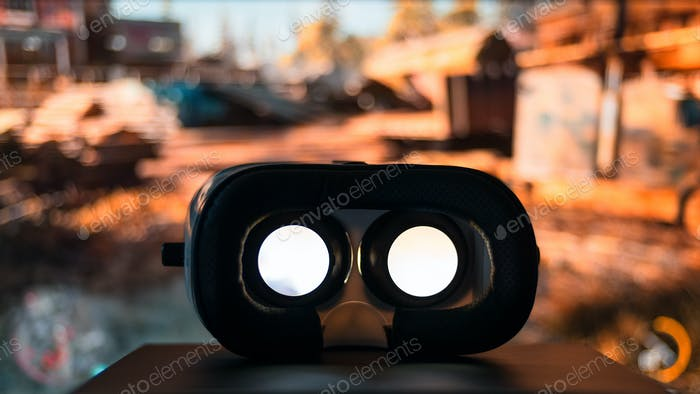 VR device playing movie inside with monitor display