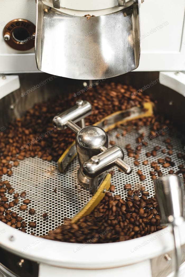 Fresh roasted coffee beans in a modern coffee roasting machine