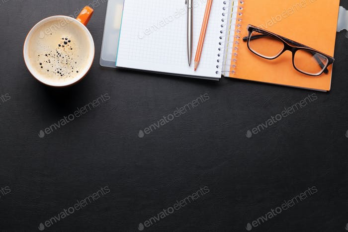 Office desk with coffee and supplies