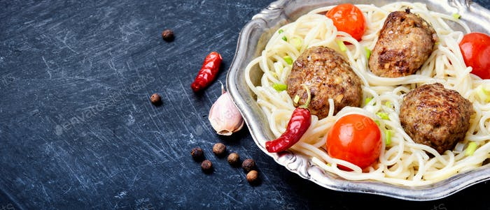 Meat cutlets and pasta
