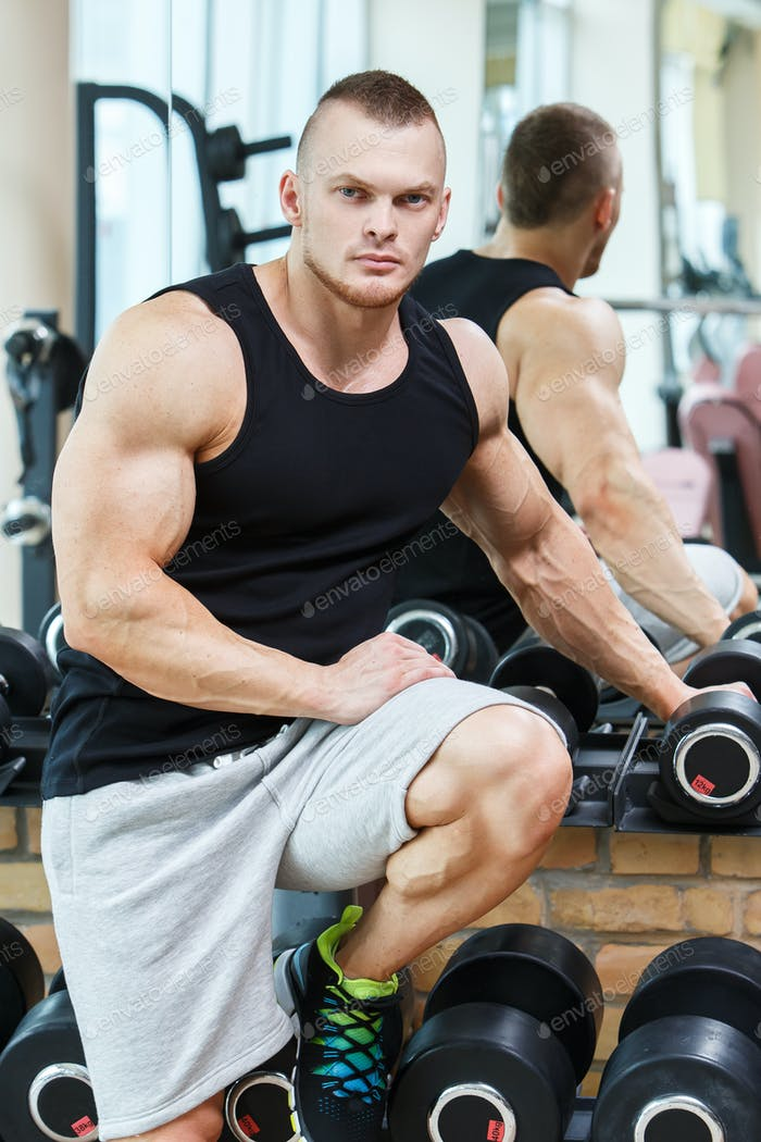 Fitness. Handsome man in the gym