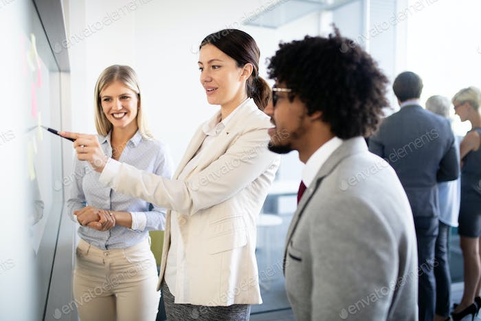 Business people working discussing as a team at the office