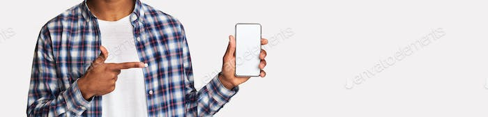 African-american guy showing blank cellphone screen, panorama