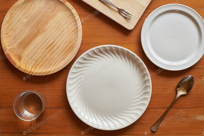 Flat lay of three plates and some cutlery