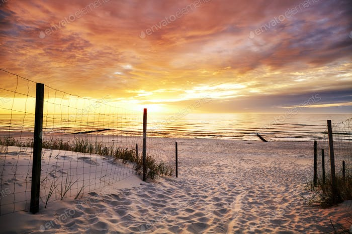 Beach entrance at a beautiful sunset.