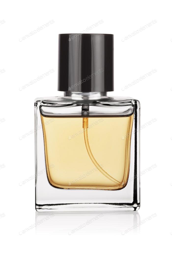Elegant transparent bottle of yellow perfume isolated on a white.