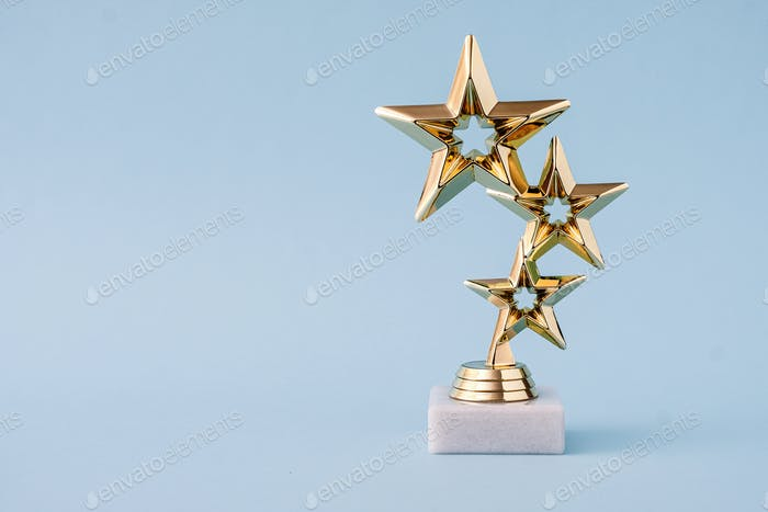 Three star awards for leader and ranking. Golden shiny prize on a pastel blue background.
