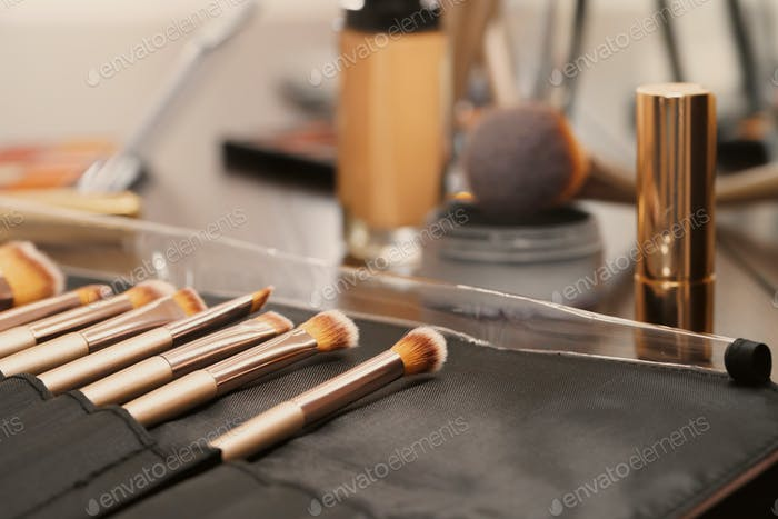 Decorative cosmetics and tools on dressing table in makeup room