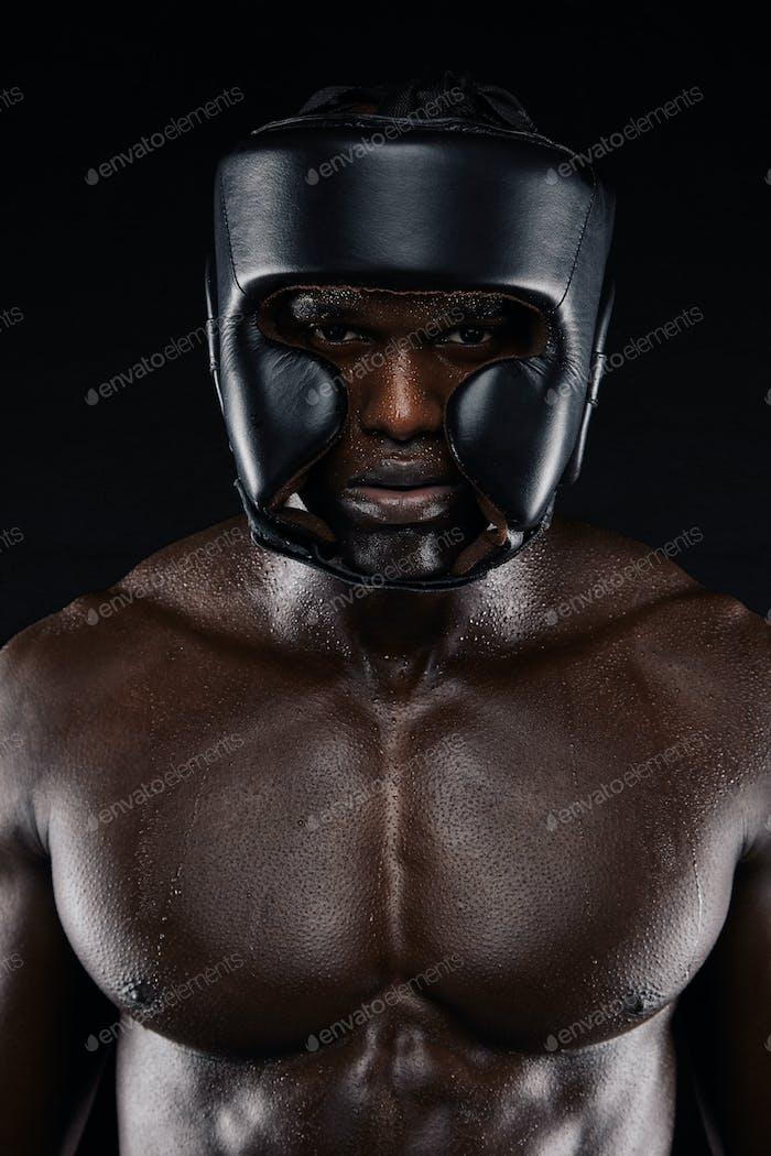 African boxer wearing protective head guard