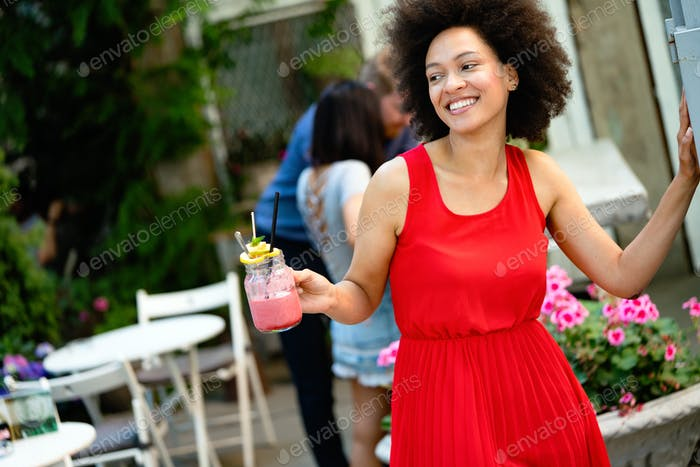 Young african woman enjoy healthy vegetarian smoothie for weight loss