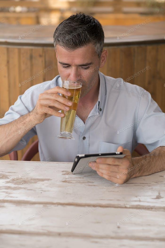 Man having a drink at the bar