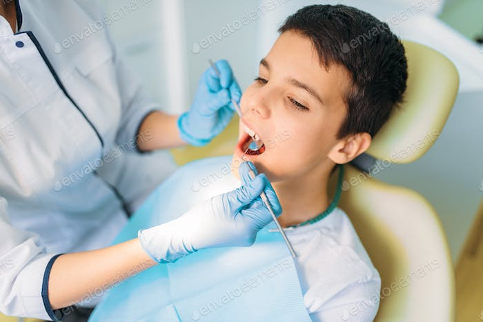 Boy with open mouth in a dental chair